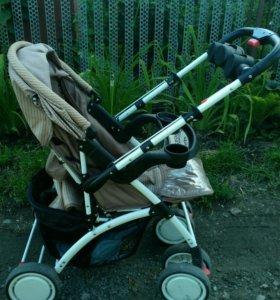 Детская коляска с перекидной ручкой