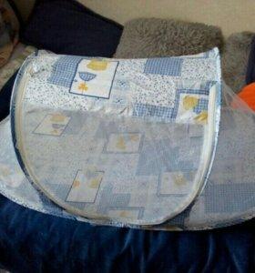 складная детская кроватка с противомоскитной сетко