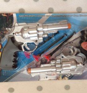 2 Пистолета игрушечных с пульками.
