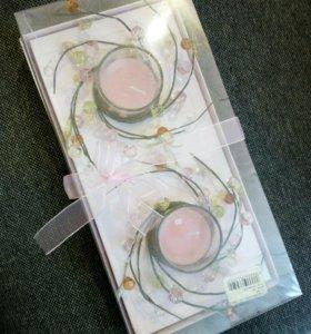 Подсвечники со свечами в подарочной упаковке.