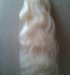Шикарный шиньон из натуральных волос.