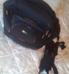 Фирменная сумка для зеркального фотоаппарата Новая