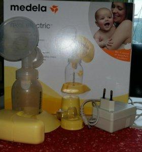 Молокоотсос Medela Электрический