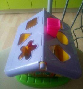 Игрушки:домик-сортер, фотоаппарат муз.