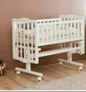 Кровать-люлька для новорожденного