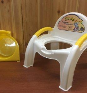 Горшок-стульчик с ручками новый ( в упаковке)