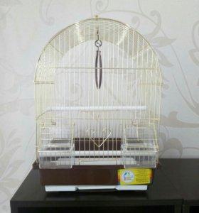 Прекрасная золотая клетка для Вашей птички