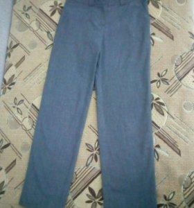 Новые серые брюки для девочки на рост до 134 см.