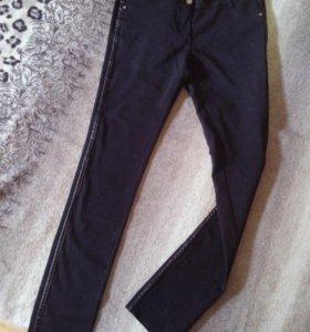 Новые скинни-штаны с кожаными вставками