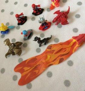 """Игрушки из киндеров """"Герои Марвел и драконы""""."""
