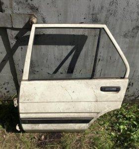 Corolla E80 дверь задняя левая