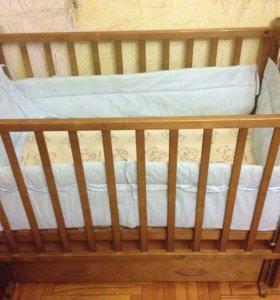детская кроватка маятниковая