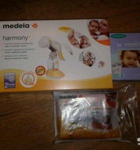Молокоотсос ручной Medela harmony + соска+ пакеты для хранения молока + пакет для стерилизации