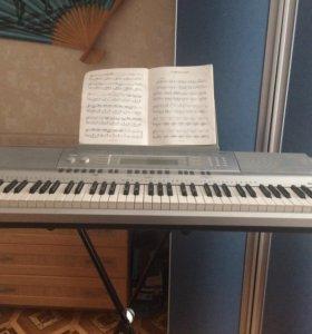 Электрический синтезатор Casio WK-210