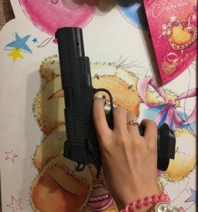 Игрушка пистолет с пулями