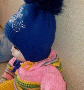 Продам зимнию шапку