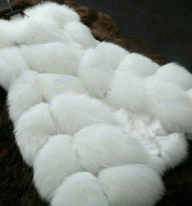 Продам жилетку меховую новую