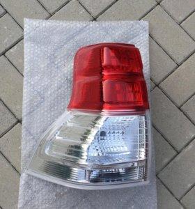 Задний фонарь внешний левый (оригинал) новый