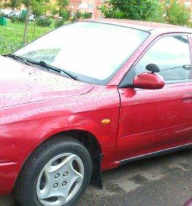 Автомобиль Kia Shuma 2000 г