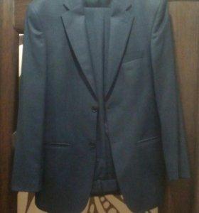 Новый костюм мужской темносиний с брюками