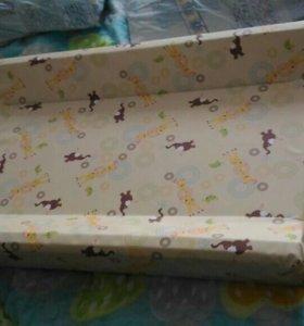 Доска для пеленания на детской кроватке