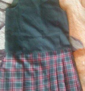 Школьная форма для девочки: сарафан, юбка и жилет.