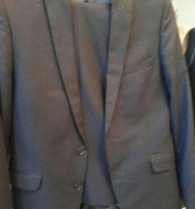 Новый костюм 170 см 46 размер
