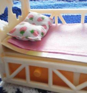 Кровать для кукол Барби.