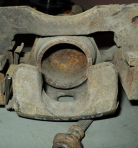 Суппорт тормозной Nissan Pulsar