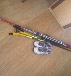 Лыжы, палки и ботинки