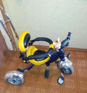 Детский трехколесный велосипед+ игрушка