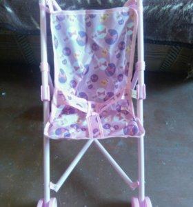 Новая игрушечная коляска для куклы