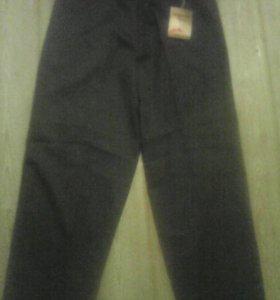 Новые брюки 34р