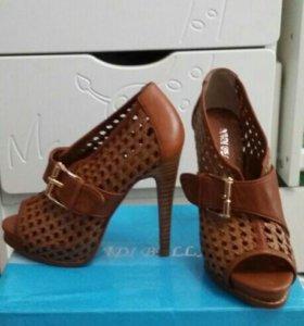 Новые кожанные туфли.не разу не одела