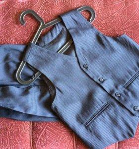 Новые школьные брюки и жилетка