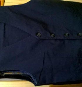 Костюм(брюки+жилет)темно-синий на 10-12 лет