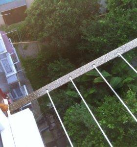 Кронштейны сушилки за окном