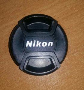 Крышка на объектив фотоаппарата