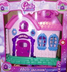 Кукольный домик,с небольшим количеством мебели.