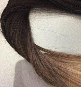 Набор на заколках из натуральных волос.