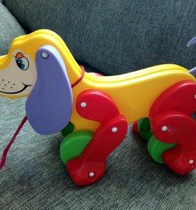 Собачка на колёсиках