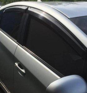 Каркасные шторки для передних дверей автомобиля.