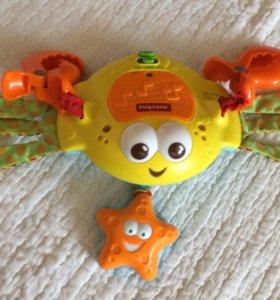 Музыкальный краб игрушка tiny love