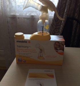 Молокоотсос ручной Medela