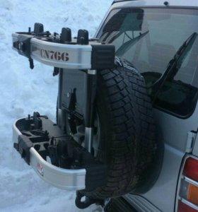 Крепление на запасное колесо- Rear Tire inno CN766