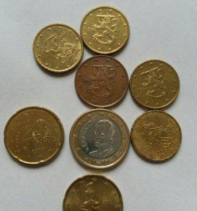 Монеты €