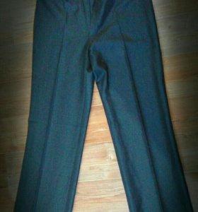 Новые качественные брюки 42 размер
