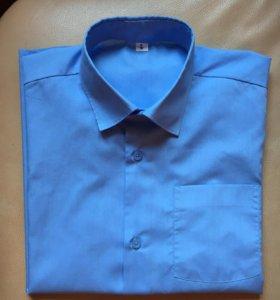 Рубашка голубая фирмы Элита 146