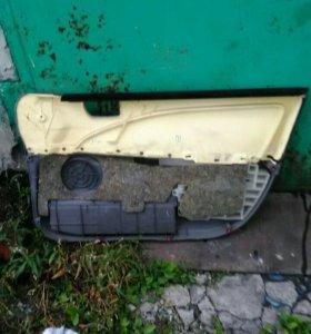 Обшивка двери леваяTOYOTA СARINA 212 кузов