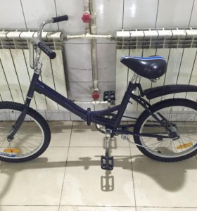 Синий складной велосипед